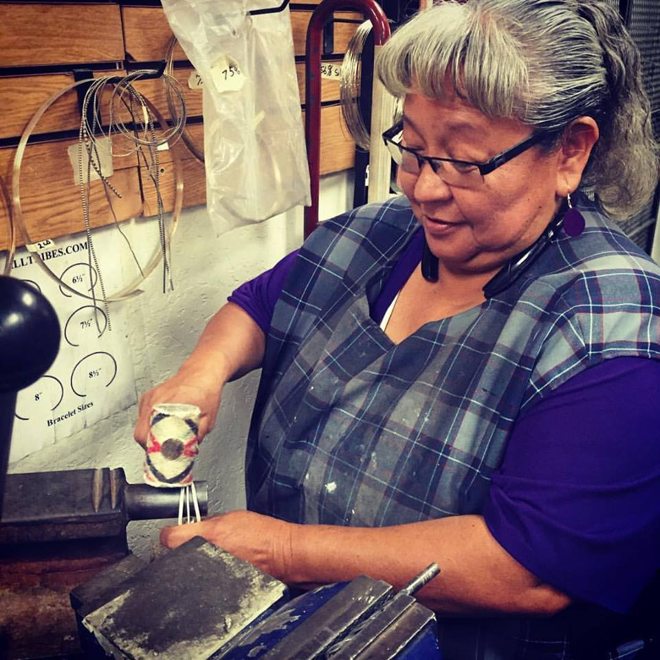 Navajo silversmith working in our shop