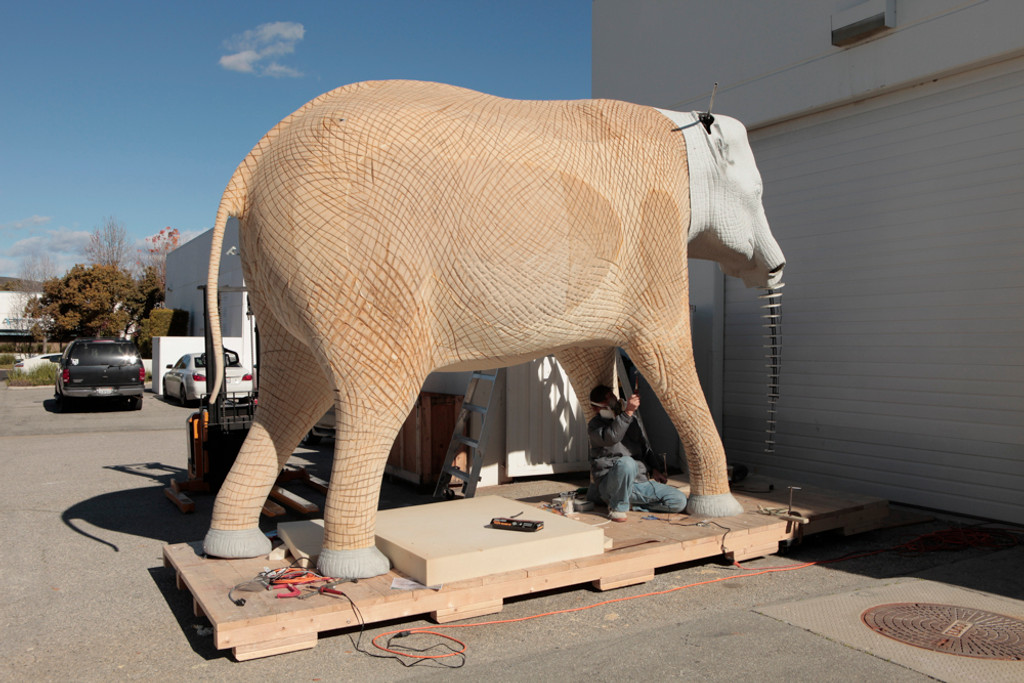 paint and coatings being applied on a lifesized, realistic elephant replica