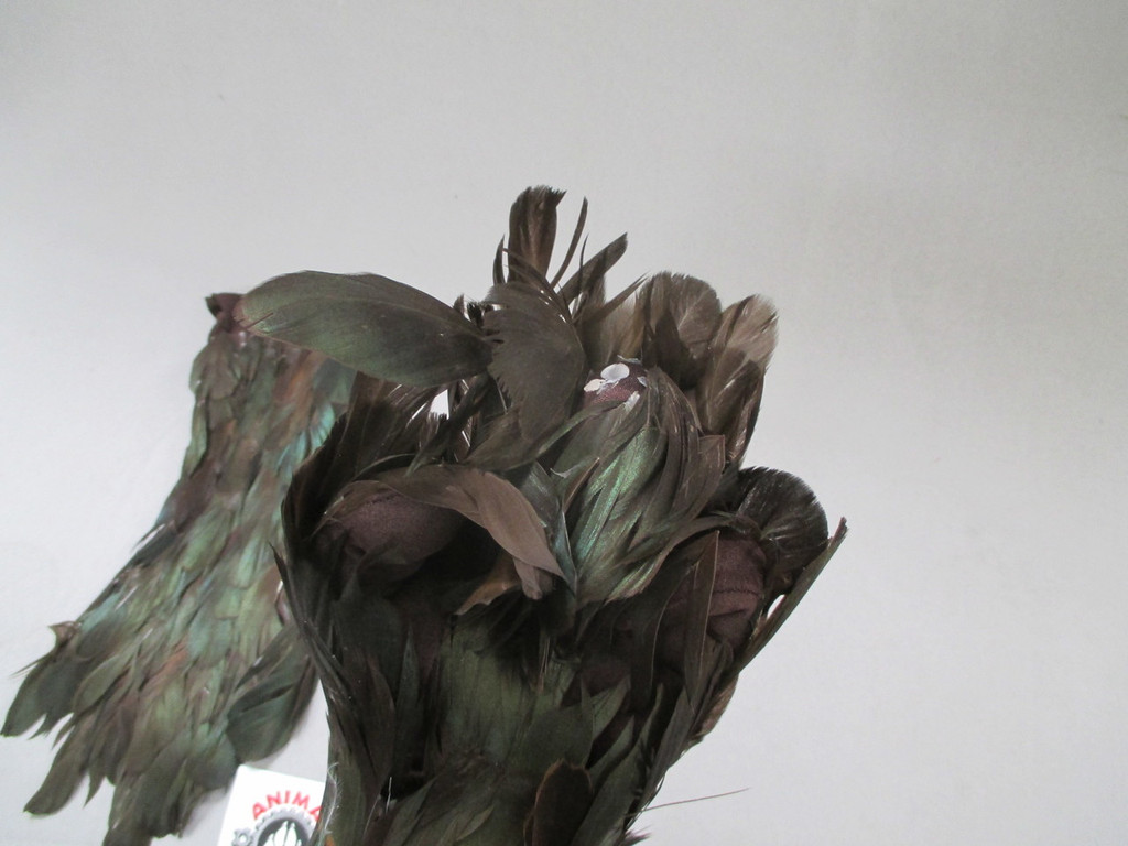 conceals the hands when working with similar colored feather creatures