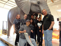 The Animal Makers crew standing in front of the elephant replica