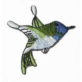 Blue Hummingbird Flying Right