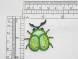 "Beetle Patch Sparkle Iron On Patch Applique   Embroidered on Sparkle Backing with Rayon Threads   Measures 1 7/16"" high x 1 7/16"" wide approximately"