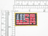 "USA Iron On Patch Applique Stars & Stripes  Embroidered on a Black Backing with Flag Yellow Border  Measures 1 1/2"" high x 3/4"" wide approximately"