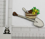 Shovel and Basket with Flowers.