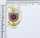 """Ships Wheel in Anchor Crest  Sailing Applique  Embroidered on Twill Backing with Rayon and Metallic Threads  Measures 3 1/4"""" high x 2"""" wide approximately"""