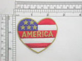 "Stars & Stripes Flag Heart Iron On Patch Applique   Embroidered with rayon and Metallic Thread on a White Twill Backing   Measures 2 1/2"" across by 2 1/4"" high"
