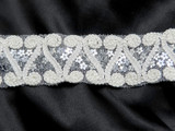 """Scroll & Sequin Mesh Trim 1 1/2"""" Sparkly White Per Yard  The sequins are a silver color in a flower shape  Very sparkly"""