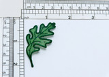 """Oak Leaf Sheer Glitter Dot Green Iron On Applique  Embroidered Border and vein detail on a sheer backing with multi glitter dot details  Measures 2 1/8"""" long x 1"""" wide"""