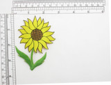"""Sunflower on Stem Embroidered Iron On Patch Applique Embroidered on a Yellow Sateen Backing Measures 2 3/8"""" across x  3 1/2"""" high"""