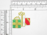 """Christmas Holiday Gifts Iron On Patch Applique   Embroidered in Rayon & Metallic Threads on White acetate backing  Measures 1 3/8"""" across  1 3/8"""" high approximately"""
