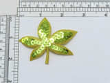 """Iron On Patch Applique - Lime Green Sequin Leaf with Gold Border  Gold Metallic Embroidered Border filled with sewn on Lime Green Sequins  Measures 2 1/4""""high x 2 3/4"""" wide approximately"""