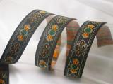 """Jacquard Ribbon 15/16"""" Black Orange green & Met Gold  Priced Per Yard"""