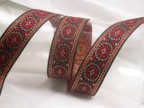 """Jacquard Ribbon 1 1/8"""" (28.5mm) Red Gold & Black Pinwheel Priced Per Yard"""