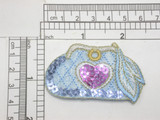 """Sequin Purse Pocket Book Cosmetic Bag Embroidered iron On patch  Embroidered On Blue Backing with Blue & Purple Sequins  Measures 1 1/2"""" high x 2 1/2"""" wide approximately"""