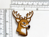 """Stag Deer Head Iron On Applique Fully Embroidered  Measures  1 5/8"""" across x 2 1/4"""" high"""