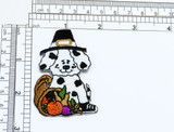 """Puppy Dog Pilgrim with Thanksgiving Vegetables  Measures 2 5/8"""" high x 1 3/4"""" wide approximately"""