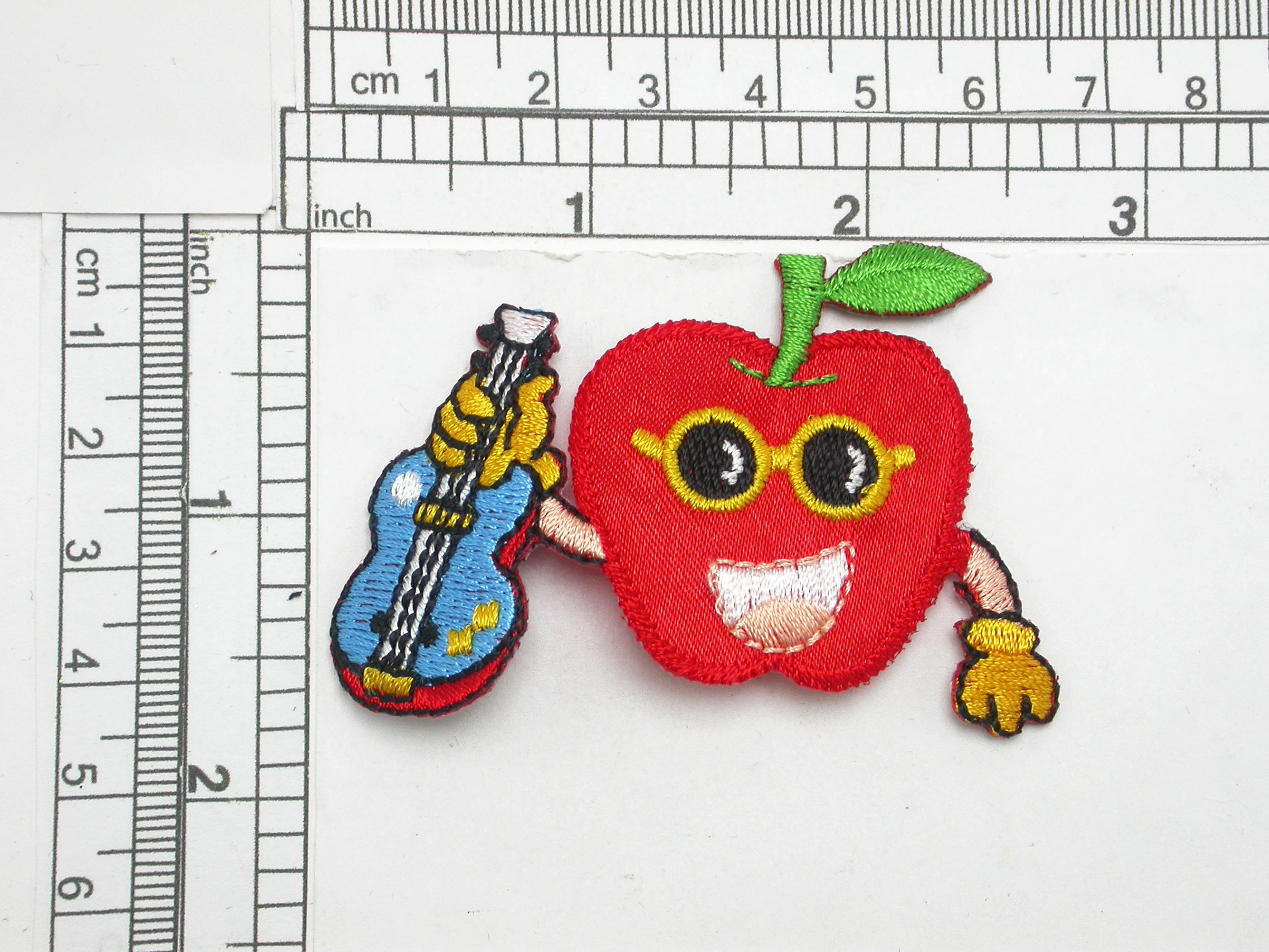 """Apple with Guitar Iron On Patch Applique Measures 1 3/4"""" high x 2 3/4"""" wide approximately"""