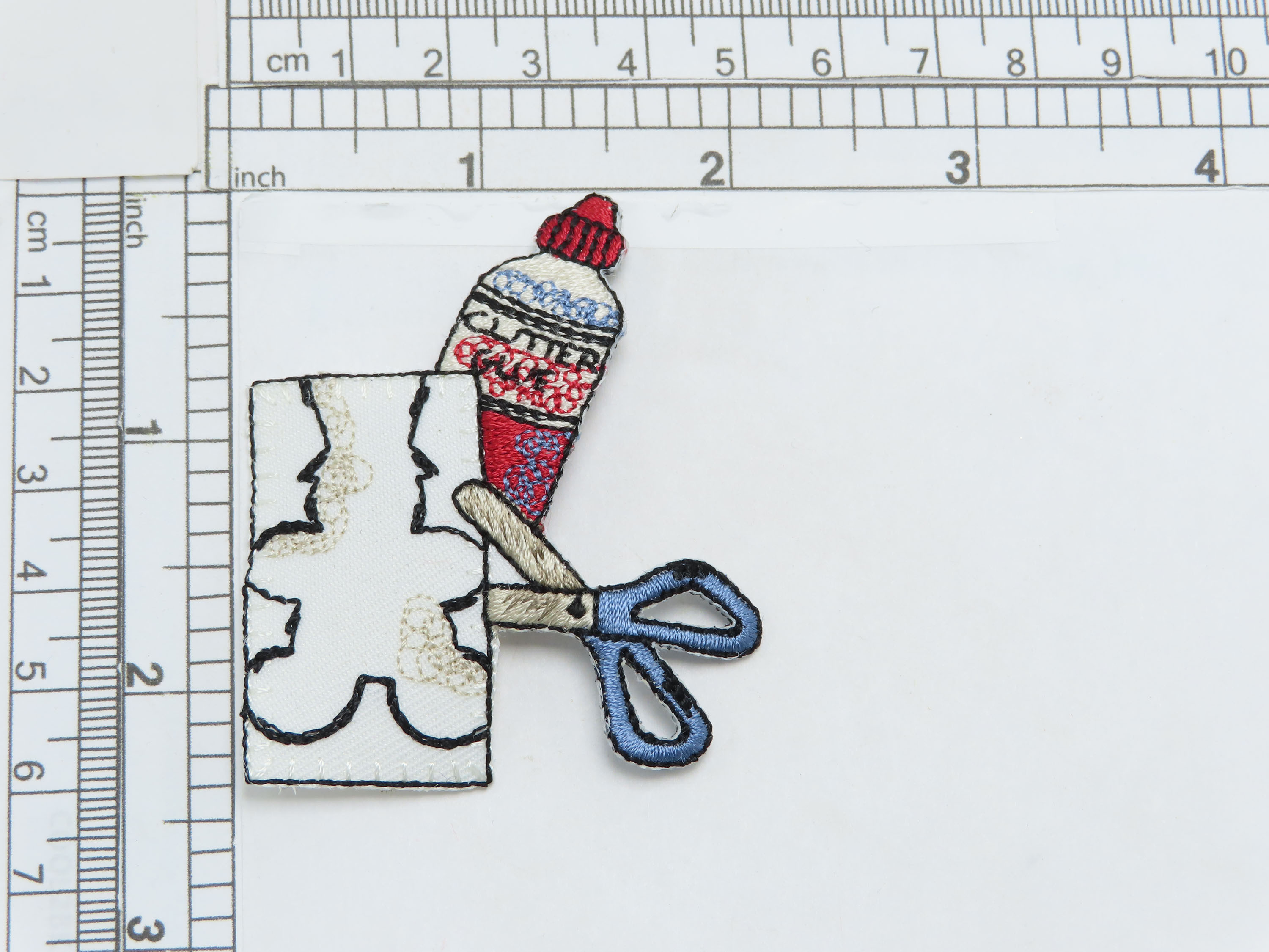 """Art Project Patch  Embroidered on Twill Backing with Rayon Threads  Measures 2 1/8"""" high x 2 3/8"""" wide approximately"""