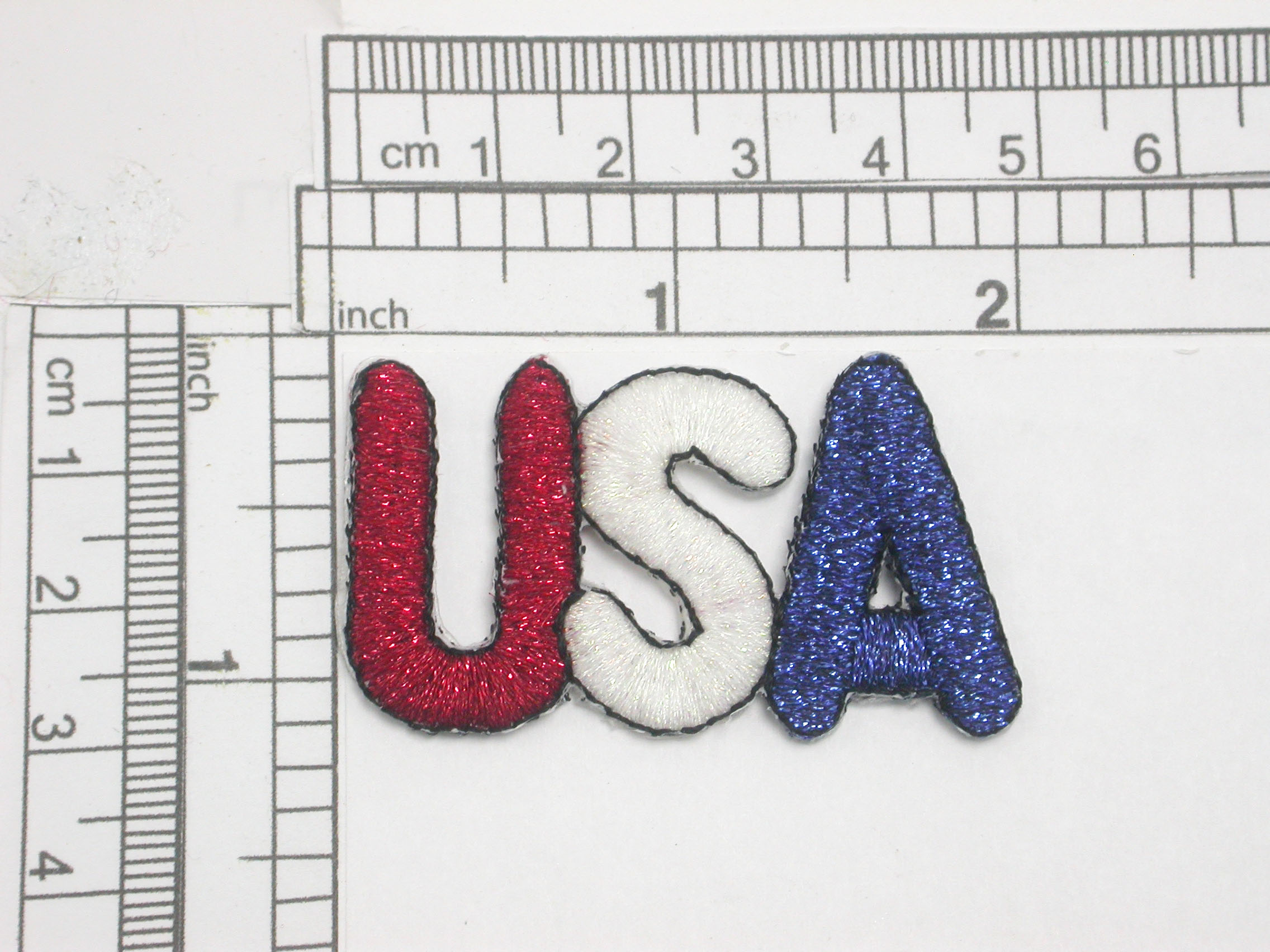 """USA Iron On Patch Applique Red White Blue Metallic Fully Embroidered in Red White & Blue Metallic Thread Measures 1 7/8"""" long x 1 1 /16"""" high"""