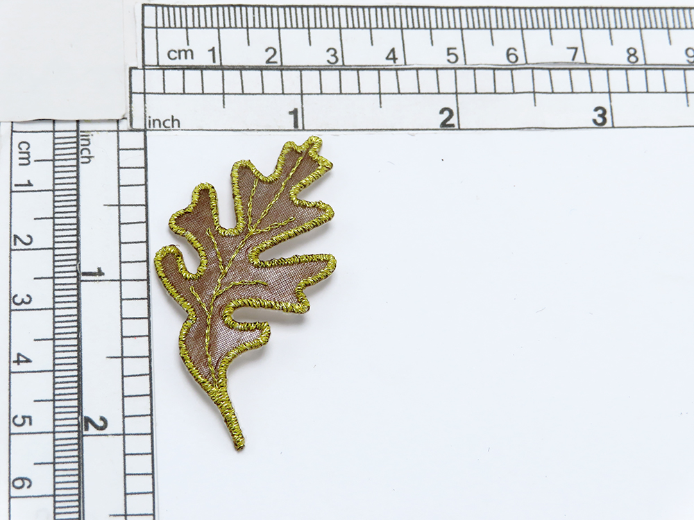 """Oak Leaf Sheer Gold Iron On Applique   Embroidered Border and vein detail on a sheer backing   Measures 2 1/8"""" long x 1"""" wide"""