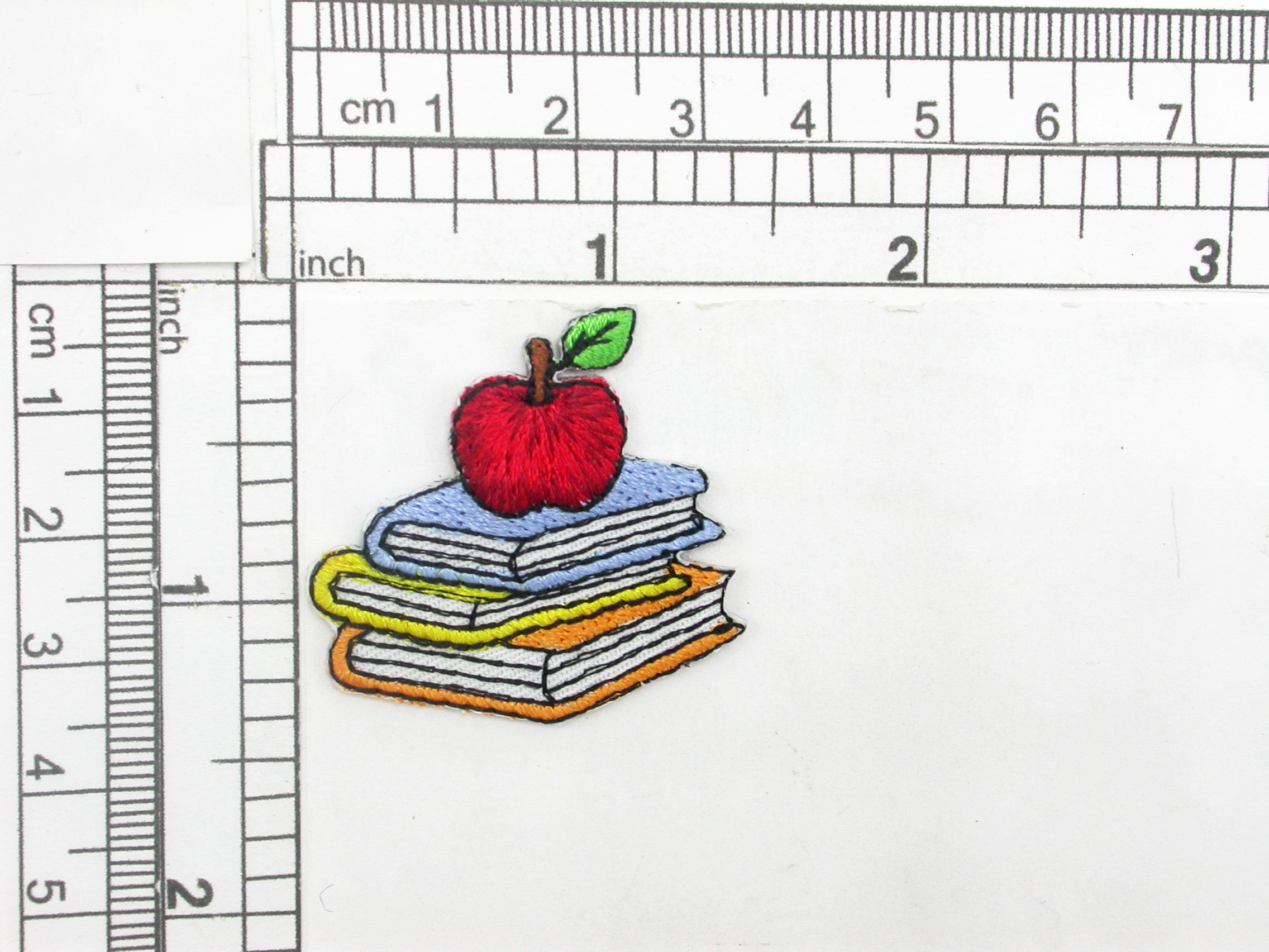 """School  Books & Apple Iron On Patch Applique    Embroidered on White Backing   Measures 1 3/8"""" high x 1 3/8"""" wide approximately"""