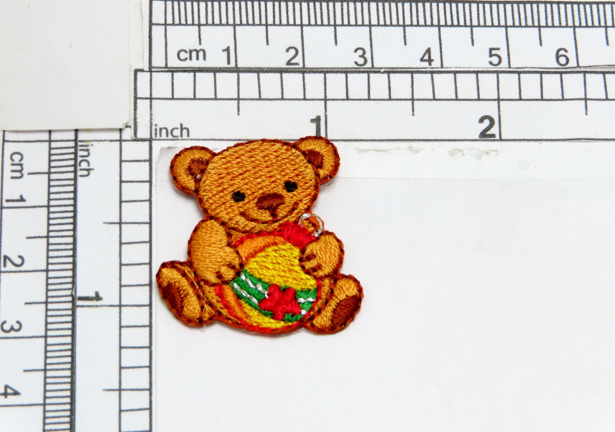 """Christmas Teddy Bear with Bauble iron on applique Fully Embroidered Measures 1 3/16"""" wide x 1 1/4"""" high"""