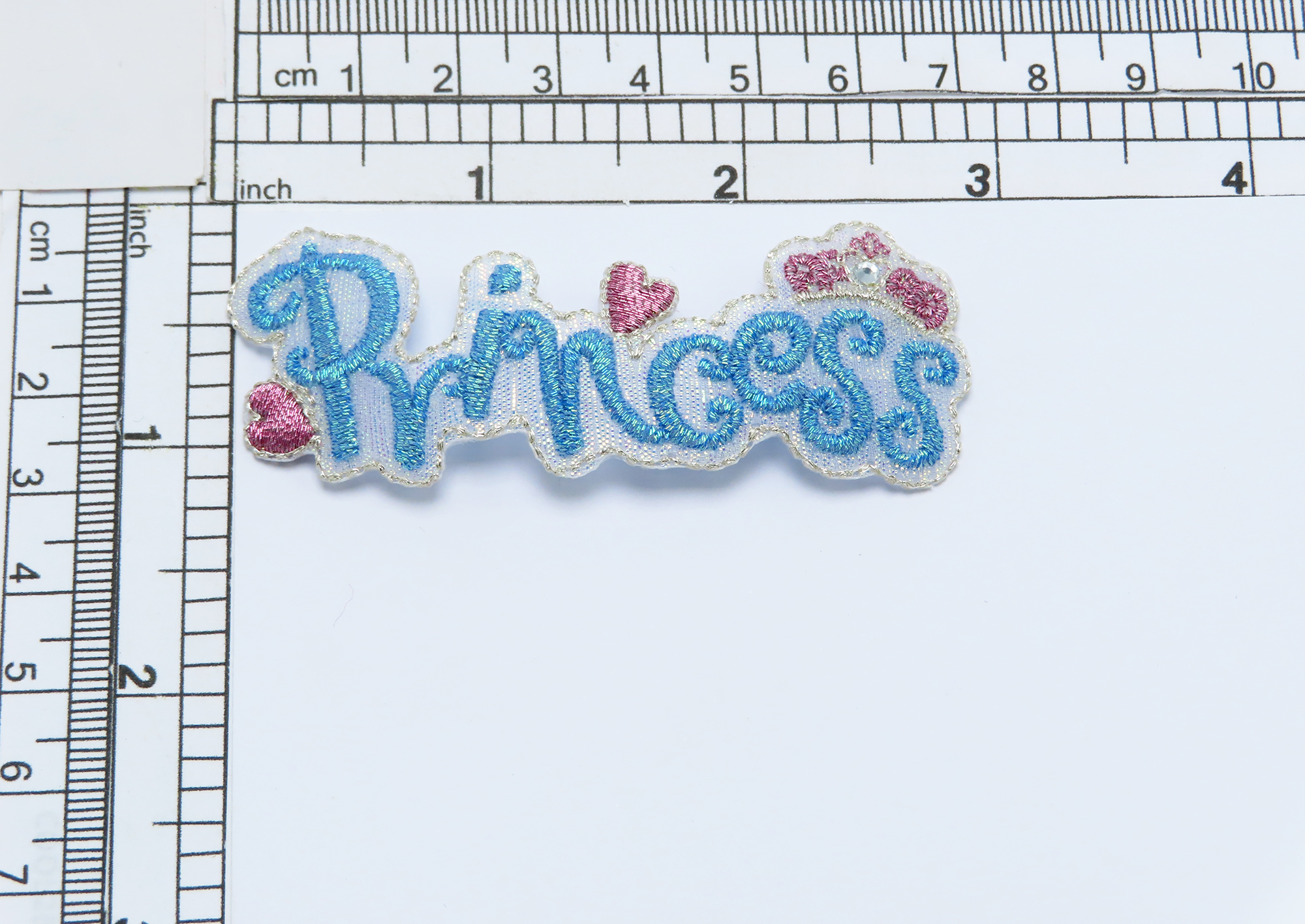"""Dancing Word Embroidered iron On Applique Embroidered on an acetate backing and detailed with Rhinestone Measures 3"""" across x 1 1/8"""" high"""