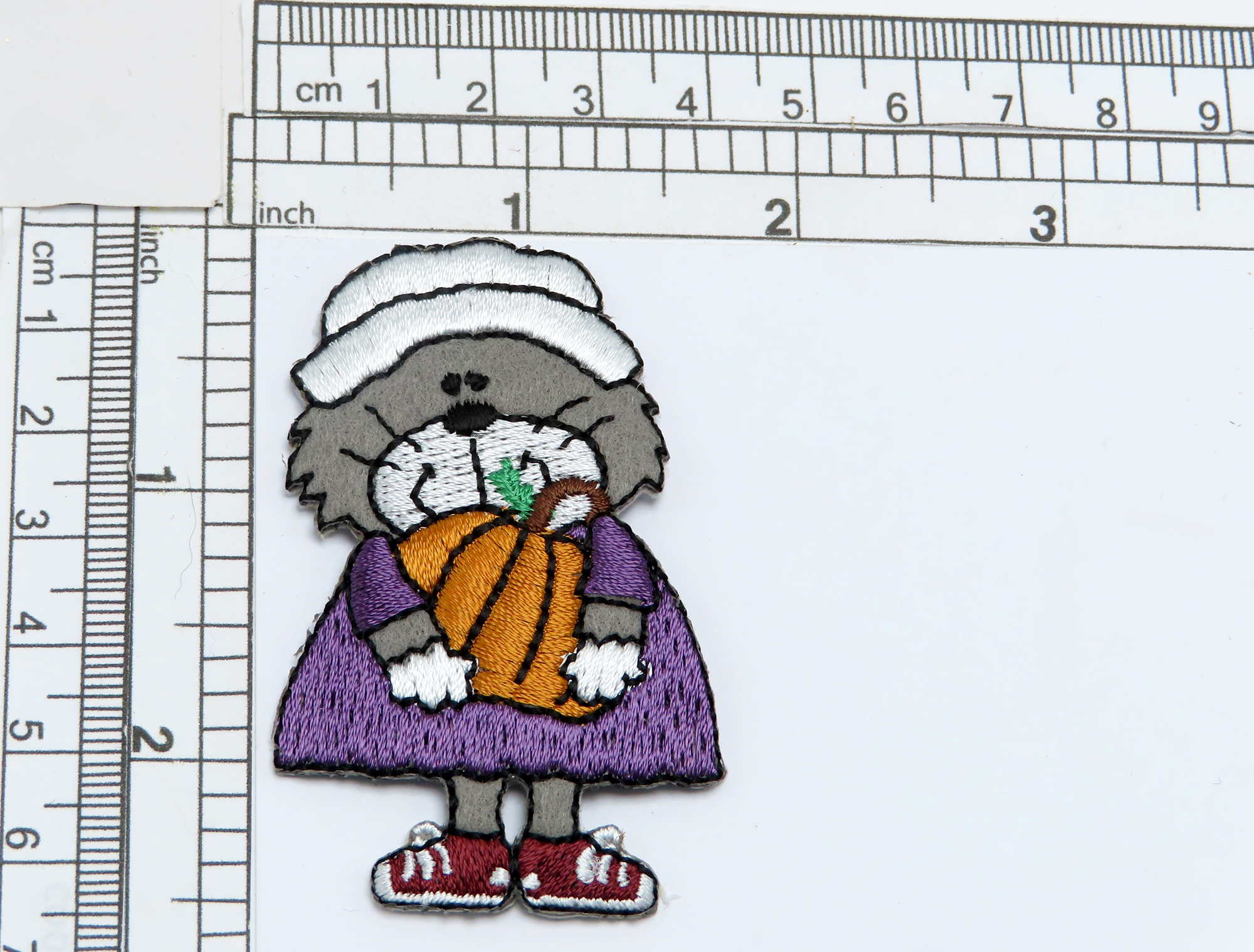 """Kitty Cat Pilgrim with Pumpkin  Embroidered on Felt Backing with Rayon Threads  Measures 2 1/2"""" high x 1 5/8"""" wide approximately"""