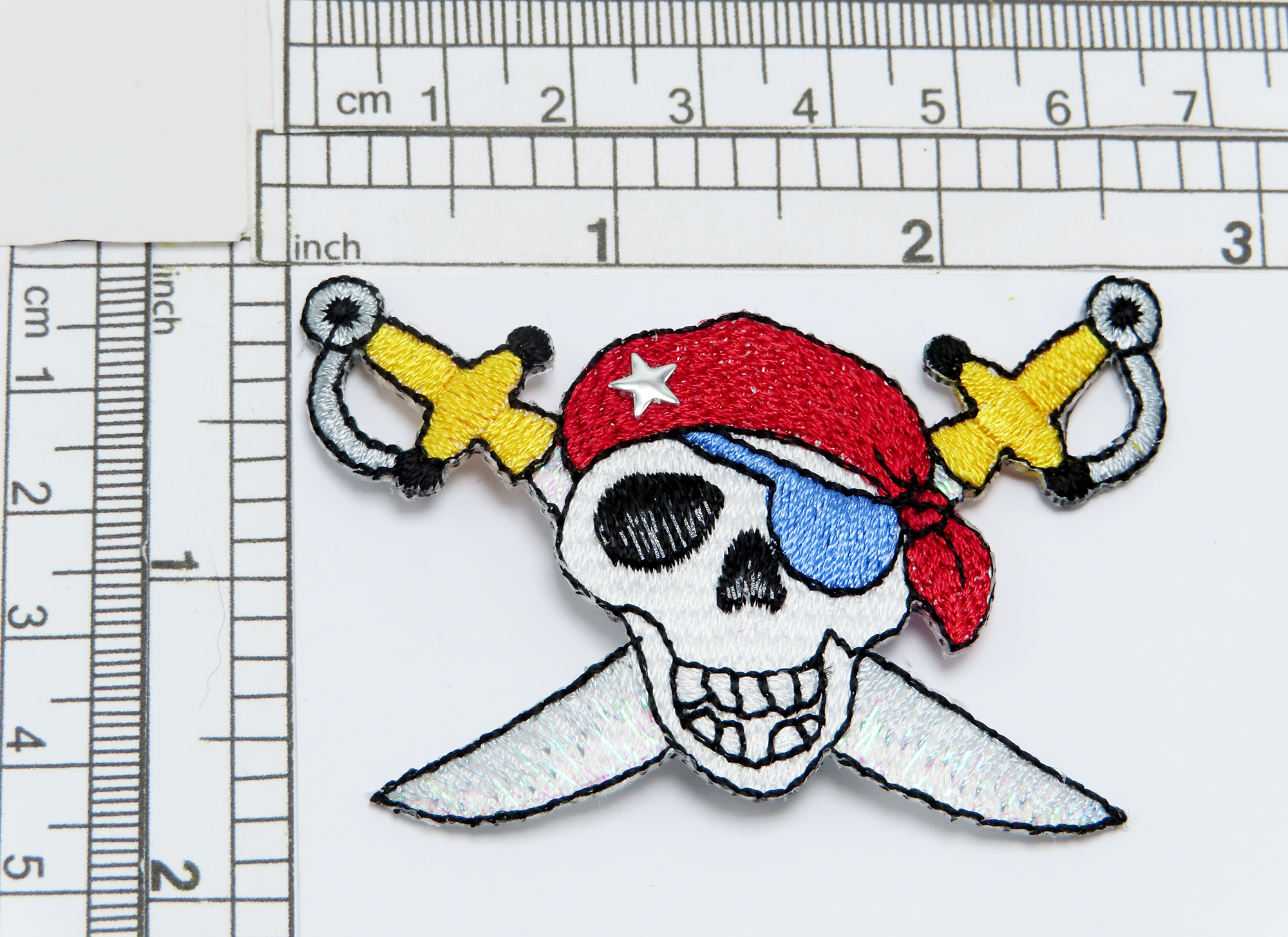 """Buccaneer Cross Swords Iron on Applique  Fully Embroidered   Measures 2 3/4"""" across x 1 3/4"""" high"""
