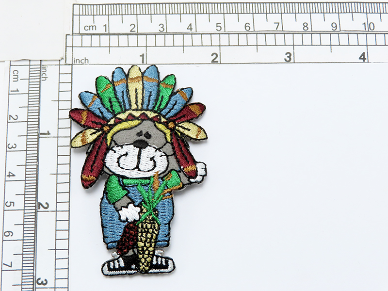 """Animal Thanksgiving with Pumpkin & Feather Headdress  Embroidered on Felt Backing with Rayon Threads  Measures 2 7/8"""" high x 1 3/4"""" wide approximately"""