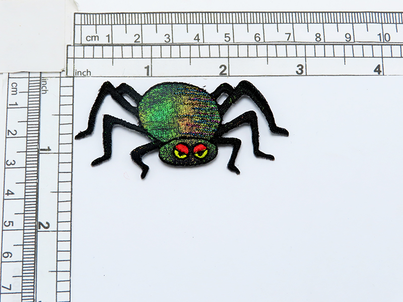"""Spider Sparkly Red Eyelids Iron On Applique Embroidered on a Black Holographic Backing  Measures 2 3/4"""" wide x 1 1/4"""" high"""