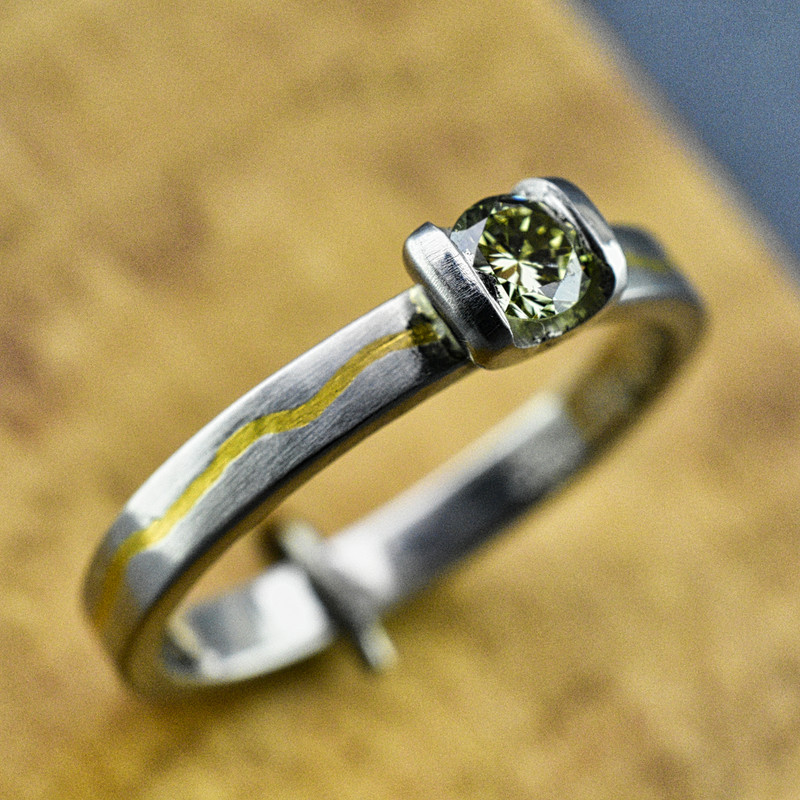 .950 Platinum Band Inlaid with 24K Gold and a .23 CT Green Diamond -SOLD-