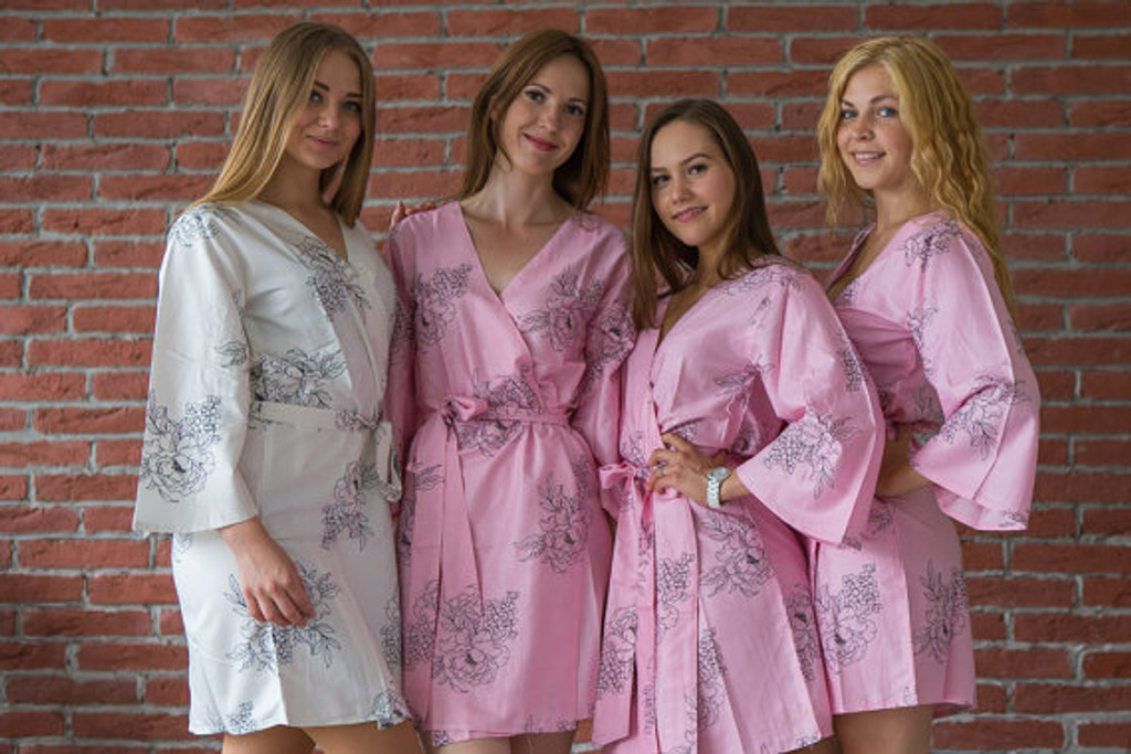 Pink bridesmaids wedding robes in floral sketch pattern