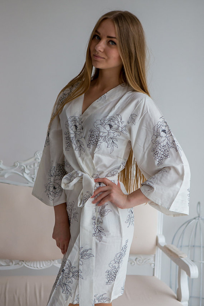 White bridesmaids wedding robes in floral sketch pattern