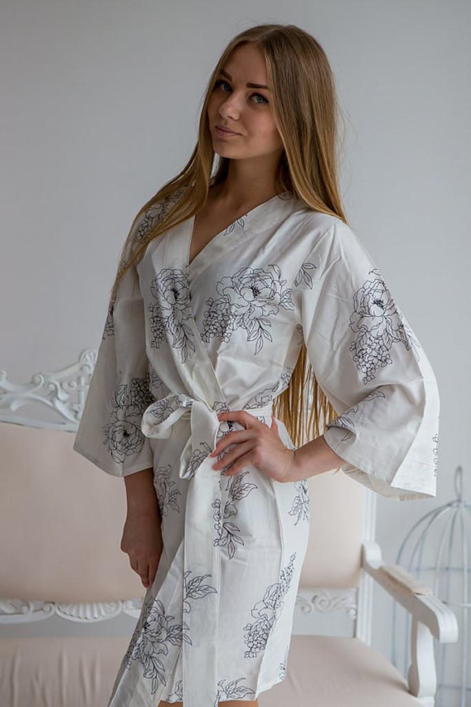 White bridesmaids wedding robes in floral sketch pattern