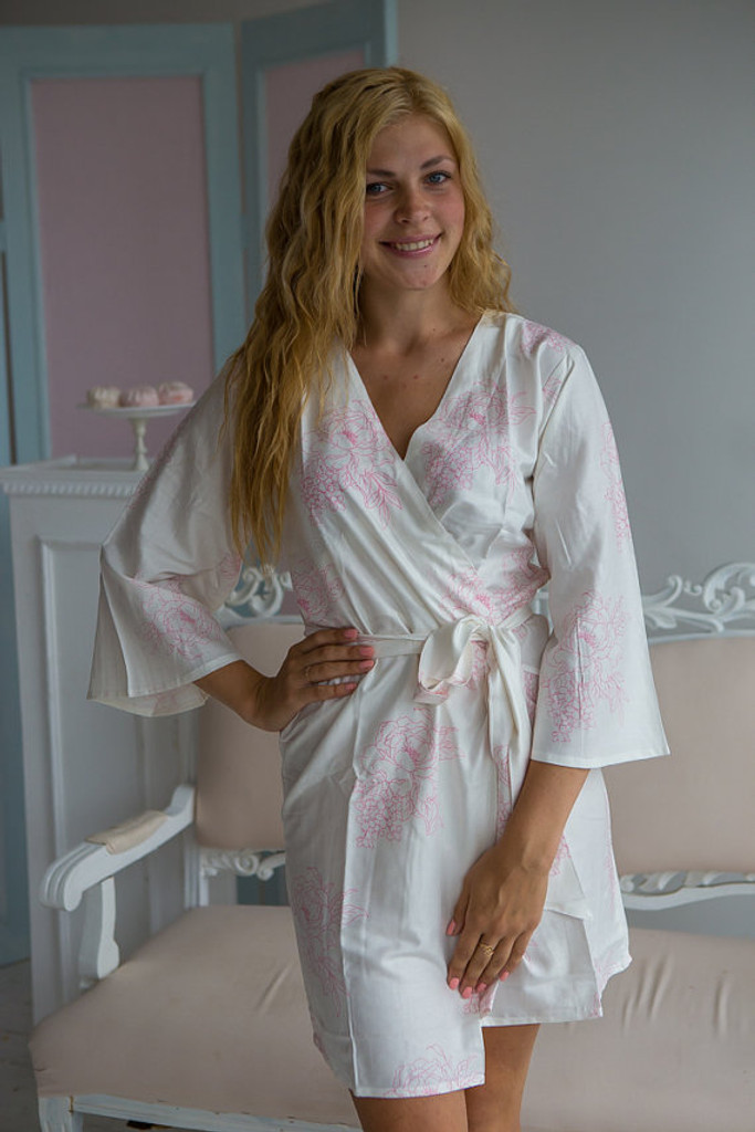 White pink bridesmaids wedding robes in floral sketch pattern