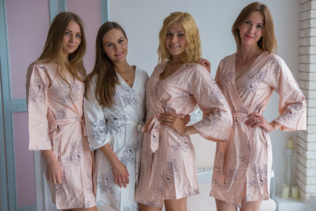 Blush bridesmaids wedding robes in floral sketch pattern