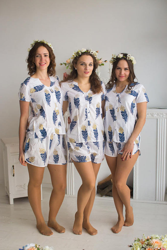 U-shaped neckline Pj Sets in a White Navy feather rhyme Pattern