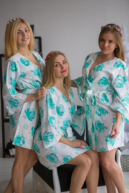 White aqua bridesmaids wedding robes in blushing flower