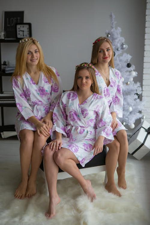 White Lilac bridesmaids wedding robes in blushing flower