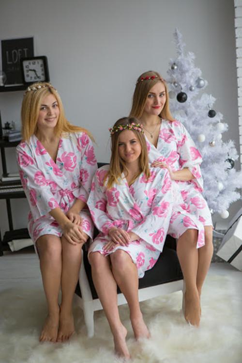 White pink bridesmaids wedding robes in blushing flower