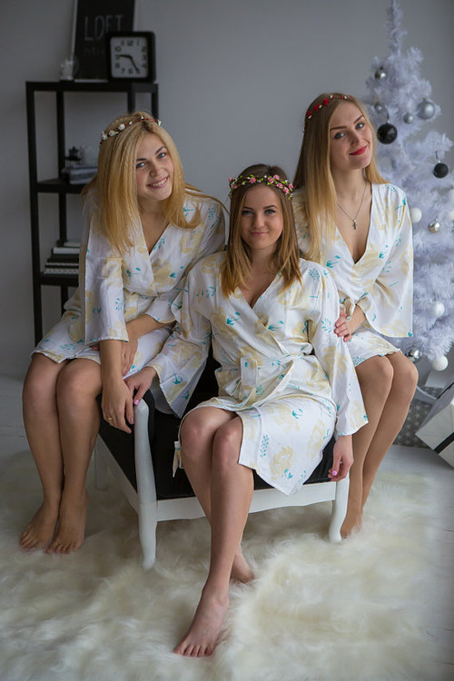 White gold bridesmaids wedding robes in blushing flower