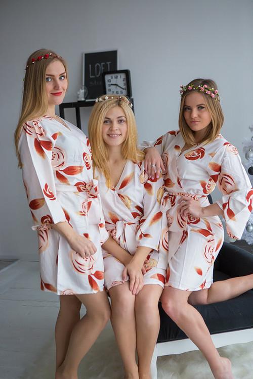 White bridesmaids wedding robes in flower pattern