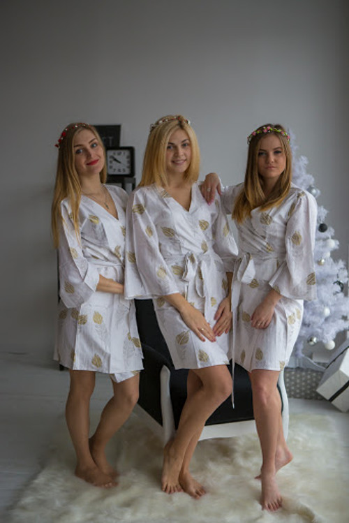 Silver and gold bridesmaids wedding robes in feather print