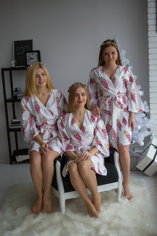 Plum and gold bridesmaids wedding robes in feather print