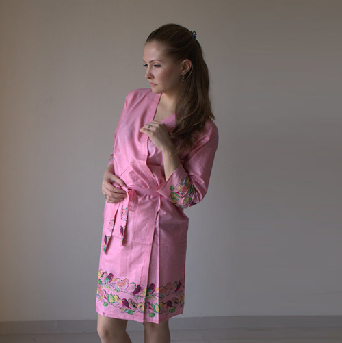 Pink colored sparrow themed robe to get ready in