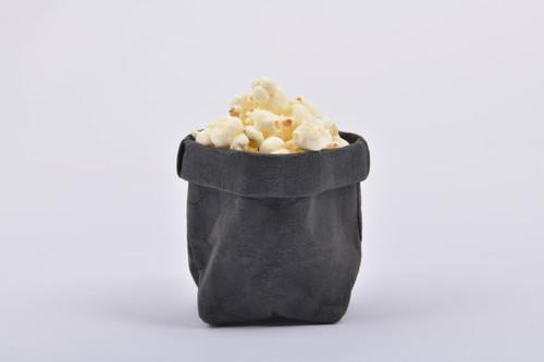 Black with popcorn