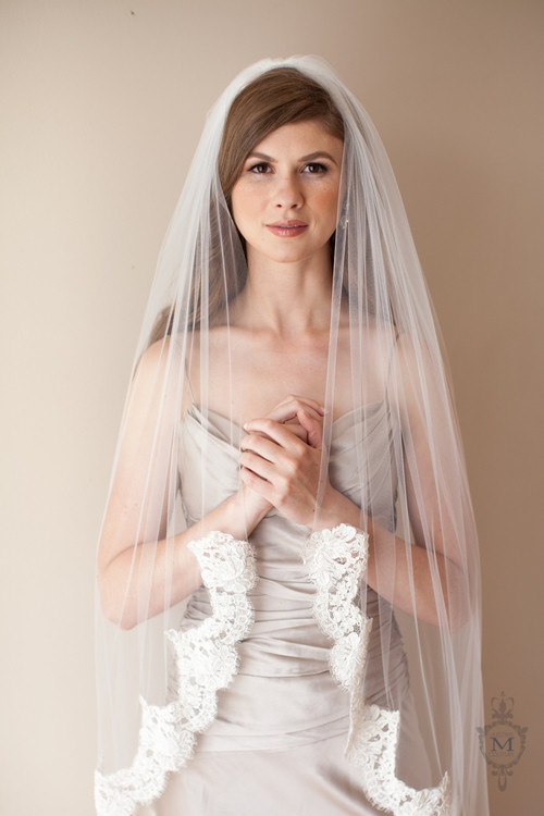 Justine M. Couture Amy Veil