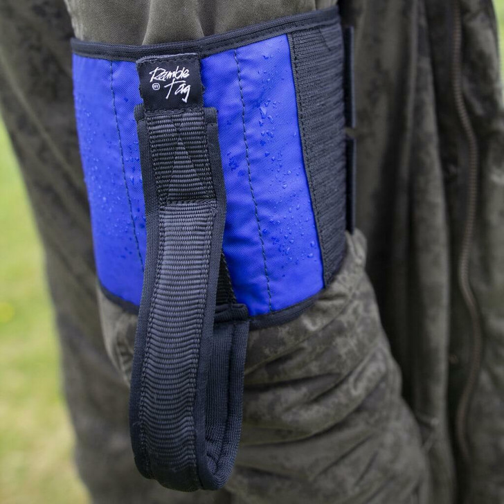 Blue Ramble Tag Original on a guides right arm providing additional mobility guidance for individuals with sight loss.