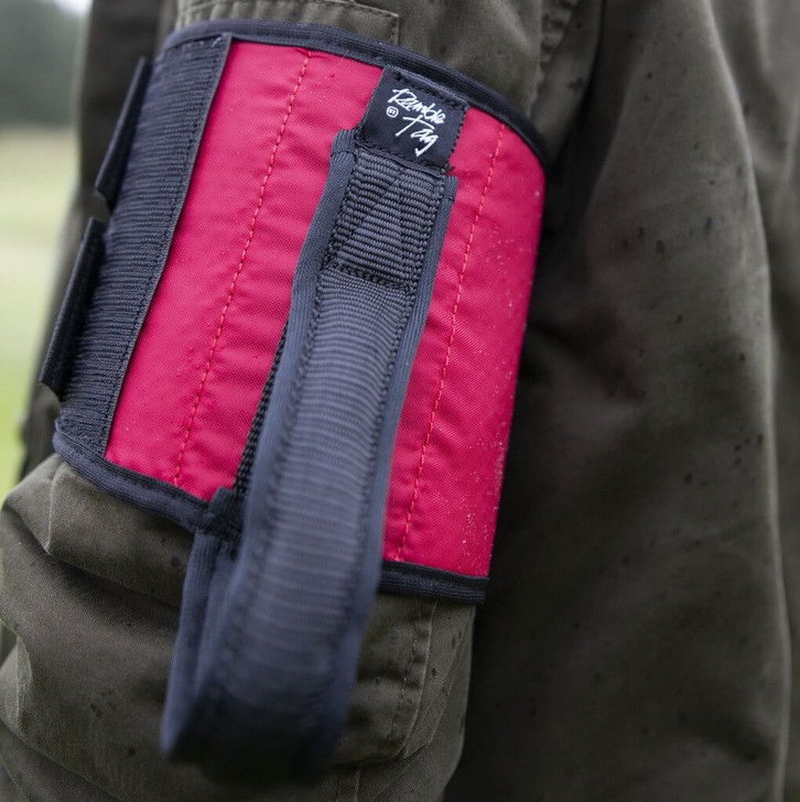 Red Ramble Tag Original on a guides right arm providing additional mobility guidance for individuals with sight loss.